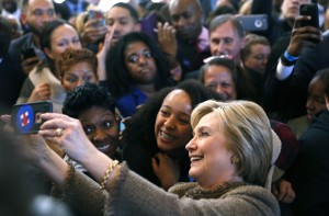 Democratic U.S. presidential candidate Hillary Clinton takes selfies with people at Octane coffee shop during a campaign stop in Atlanta City Hall in Atlanta